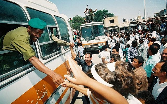 Palestinian citizens celebrating the arrival of Palestinian police in Jericho, May 13, 1994. It was one of the first cities handed over to Palestinian Authority control in 1994, in accordance with the Oslo Accords (photo credit: Yossi Zamir/Flash90)