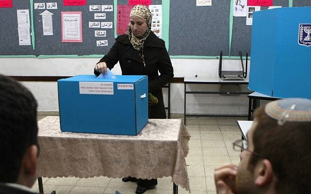 An Arab woman casts her vote in the Jerusalem suburb of Abu Ghosh, 2009 (photo credit: Flash90/Nati Shohat)