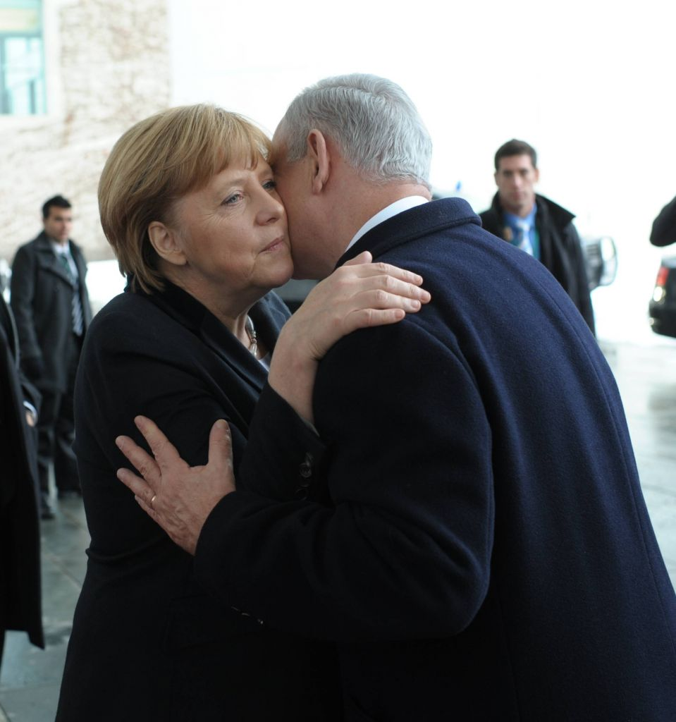 Chancellor Angela Merkel and Prime Minister Benjamin Netanyahu embrace after attending a joint press conference in Berlin, Germany on December 06, 2012. (photo credit: Amos Ben Gershom/GPO/Flash90)