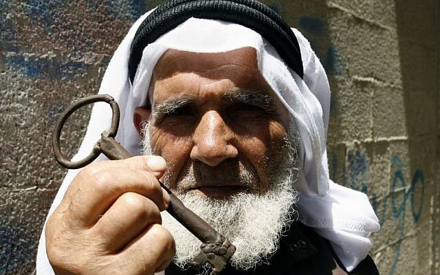 A Palestinian refugee holds up a key allegedly from his house in Beersheba, in southern Israel, during a rally in Rafah, Gaza Strip, May 2013 (photo credit: Abed Rahim Khatib/Flash90)
