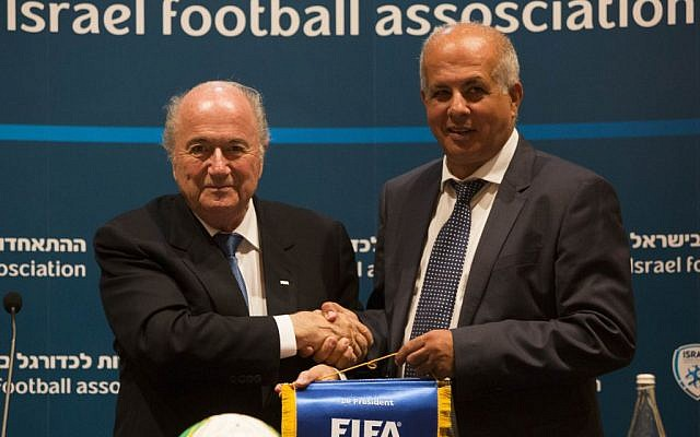 FIFA President Sepp Blatter (left) with former Israel Football Association chairman Avi Luzon during Blatter's visit to Israel in July, 2013. (photo credit: Yonatan Sindel/Flash90)