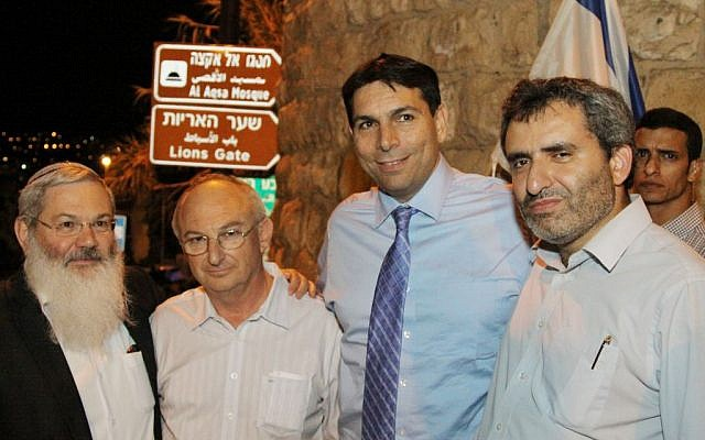Deputy ministers Eli Ben Dahan (left), Danny Danon (second right), Ze'ev Elkin (right) and former MK Aryeh Eldad outside Lion's Gate after participating a march on the eve of Tisha B'av, around the city walls of Jerusalem's Old City, July 15, 2013. (photo credit: Gershon Elinson/Flash90)