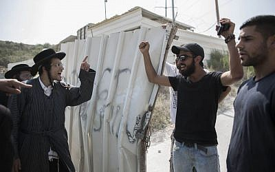 Ultra-Orthodox Jewish men shout during a demonstration in Beit Shemesh, Israel, August 13, 2013 (photo credit: Yonatan Sindel/Flash90)