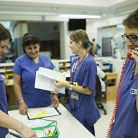 Nurses at the emergency room in the Hadassah Ein Kerem hospital in Jerusalem (illustrative photo credit: Yonatan Sindel/Flash90)