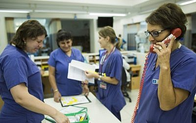 Illustrative: Nurses at the emergency room in the Hadassah Ein Kerem hospital in Jerusalem. (Yonatan Sindel/Flash90)