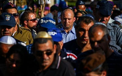 Economy Minister Naftali Bennett (in blue shirt) seen during the funeral of of Israeli soldier Staff Sergeant Gal Gabriel Kobi, 20, in the Haifa military cemetery, on September 23, 2013. (photo credit: Avishag Shaar Yashuv/FLASH90)