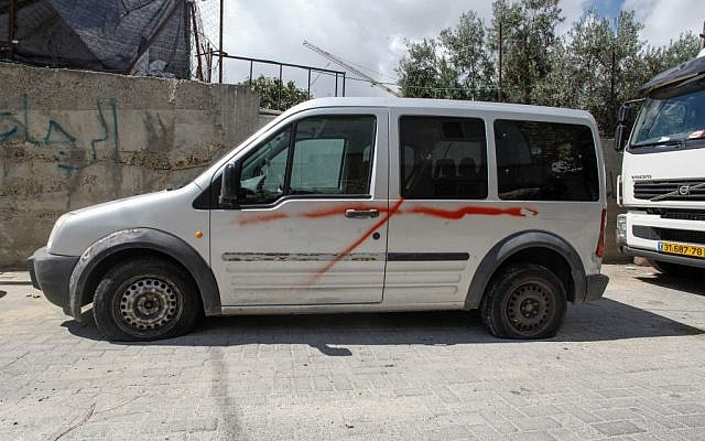 One of the vehicles vandalized in the Sheikh Jarrah neighborhood of Jerusalem, on September 22, 2013. (photo credit: Flash90)