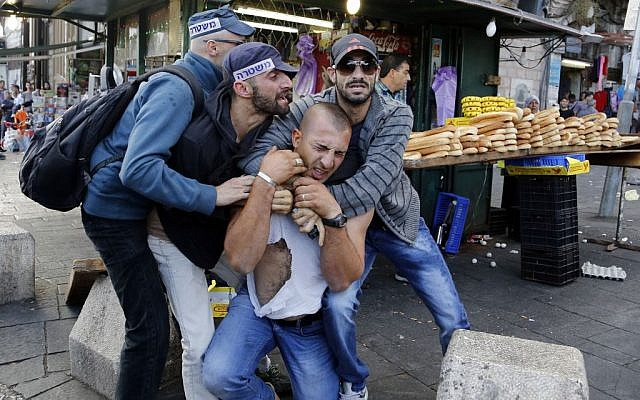 Israeli policemen detain a Palestinian man during clashes in front of Jerusalem's Old City's Damascus Gate on September 24, 2013. (Photo credit: Sliman Khader/Flash90)