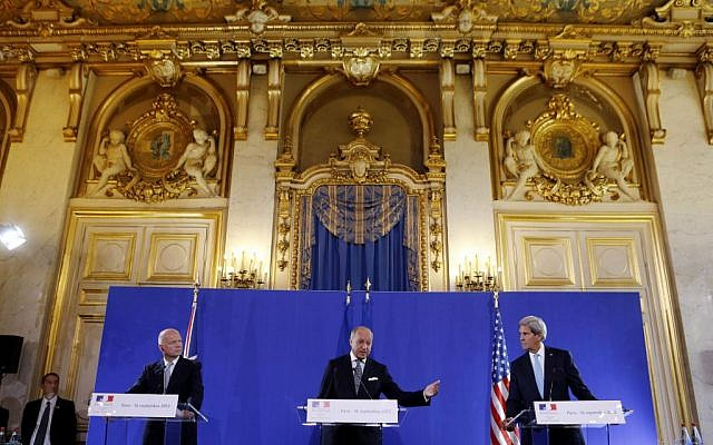 John Kerry, right, and William Hague, left, listen to French Foreign Minister Laurent Fabius speak at a news conference after a meeting on Syria, at the Quai d'Orsay in Paris, Monday, September 16, 2003. (photo credit: AP/Larry Downing, Pool)