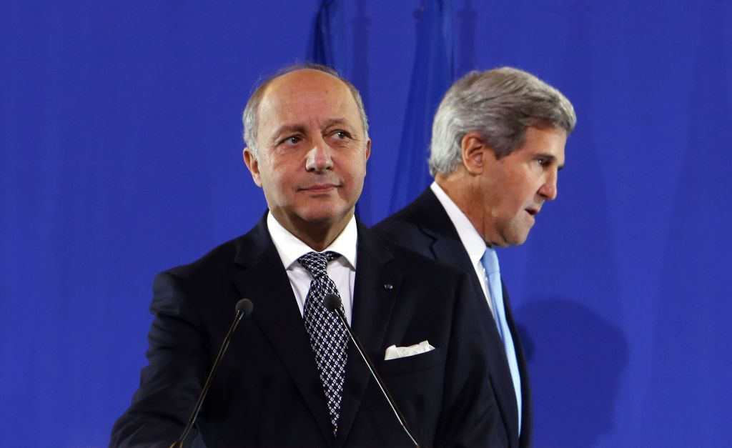 US Secretary of State John Kerry, right, and French Foreign Minister Laurent Fabius arrive for a news conference at the Quai d'Orsay after a foreign ministers meeting to discuss developments in Syria, Paris, Monday, Sept. 16, 2013 (photo credit: AP/Larry Downing, Pool)
