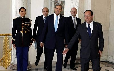 U.S. Secretary of State John Kerry, center, walks with French President Francois Hollande, right, French Foreign Minister Laurent Fabius, second left, and British Foreign Secretary William Hague, second right, before a meeting regarding Syria, at the Elysee presidential palace in Paris, Monday, Sept. 16, 2013 (photo credit: AP/Larry Downing)