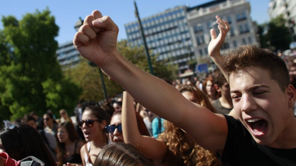 Students shout slogans as they march through the city center of Athens during a protest against the far-right Golden Dawn party, Athens, on Wednesday, September 25, 2013 (photo credit: AP/Kostas Tsironis)