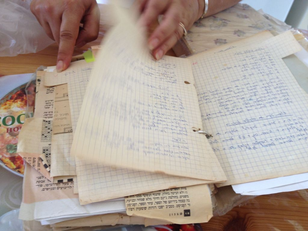 Thumbing through one of the many recipe notebooks in Ziv's collection (photo credit: Jessica Steinberg/Times of Israel)