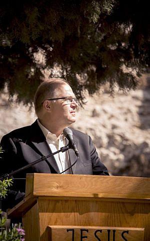 Jürgen Bühler speaks at the Garden Tomb in Jerusalem, this week (Courtesy of the International Christian Embassy Jerusalem)