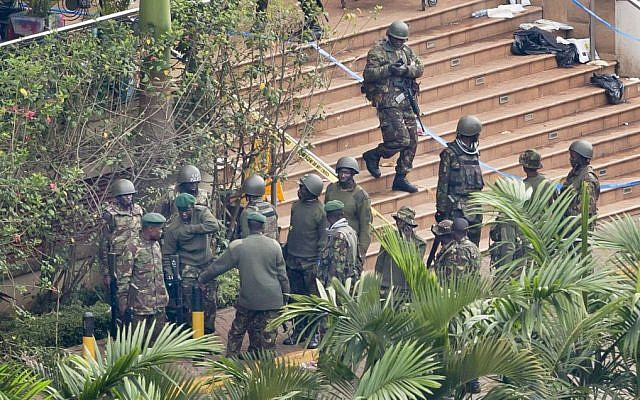 Soldiers from the Kenyan Defense Forces gather at the entrance to the Westgate Mall in Nairobi, Kenya Thursday, September 26, 2013. (photo credit: AP Photo/Ben Curtis)