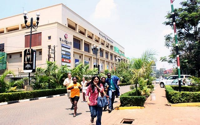 People run from the Westgate Mall, where shooting erupted when armed men staged an attack, on Saturday, September 21, 2013. (photo credit: AP/Jason Straziuso)