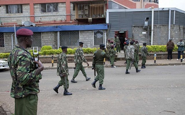 Kenya security personnel walk to their positions outside a shopping mall in Nairobi, Kenya, Sunday, Sept. 22, 2013 (photo credit: AP/Sayyid Azim)