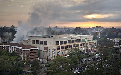 Dawn breaks over the still-smoldering Westgate Mall in Nairobi, Kenya, Thursday, Sept. 26, 2013. (photo credit: AP/Ben Curtis)