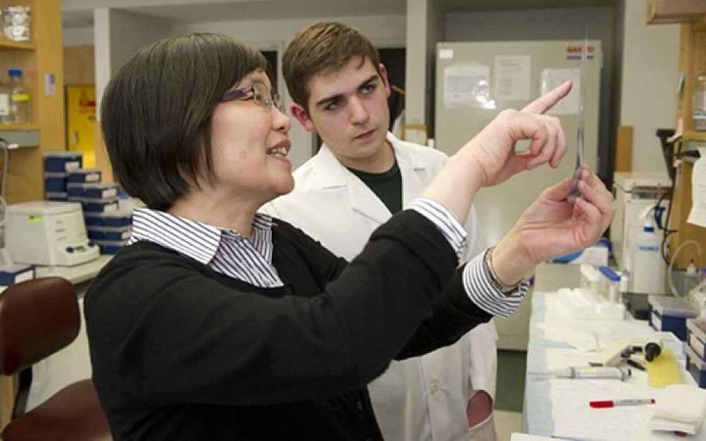 Max Wallack with Wendy Qiu, who heads the Laboratory of Molecular Psychiatry in Aging at Boston University's Alzheimer's Disease Center. (photo credit: Vernon Doucette/JTA)