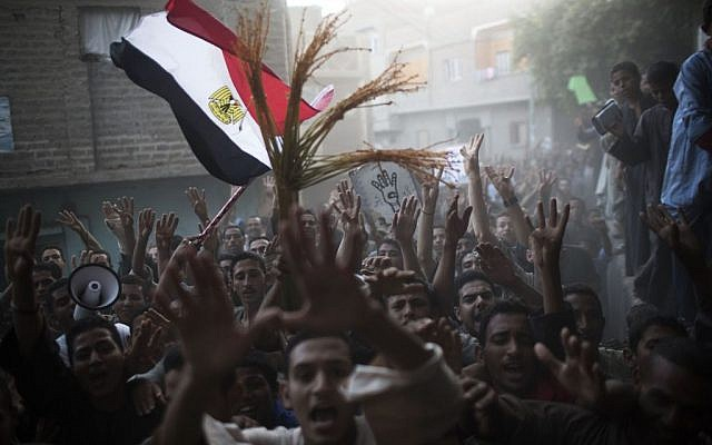 In this Tuesday, Sept. 17, 2013 photo, supporters of Egypt's ousted President Mohammed Morsi chant slogans against Egyptian Army during a protest in Dalga, south of Cairo, Egypt. (AP Photo/Manu Brabo)