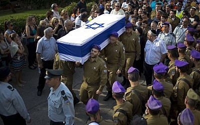 Israeli soldiers carry the flagged wrapped coffin of Staff Sergeant Gabriel Koby, during his funeral at the military cemetery in Haifa ,Israel, Monday, Sept. 23, 2013. (Photo credit: AP/Ariel Schalit)