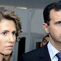 Syrian President Bashar Assad and his wife, Asma Assad, in July 2010 (AP/Hassene Dridi)