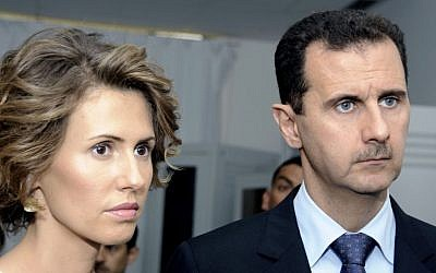 Syrian President Bashar Assad and his wife, Asma Assad, in July 2010 (photo credit: AP/Hassene Dridi)