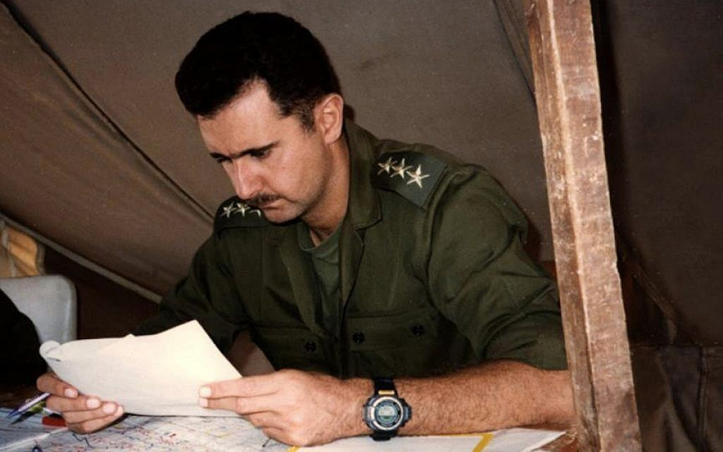 This 1994 photo posted on the official Facebook page of the Syrian Presidency, purports to show then-captain Bashar Assad, looking at documents during a military project in Syria (photo credit: AP/Syrian Presidency via Facebook)