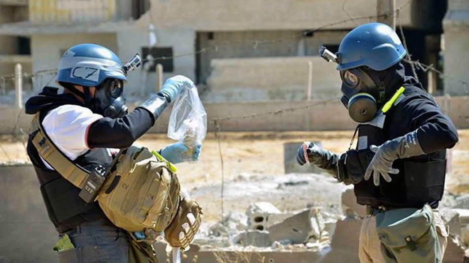 Members of a UN investigative team take samples near the site of an alleged chemical weapons attack, in Syria, Aug. 28, 2013 (photo credit: AP/United Media Office of Arbeen)