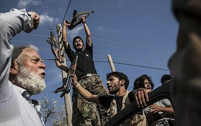 Syrian rebel fighters return from the battlefield in Idlib province, Syria, September 2013 (photo credit: AP)