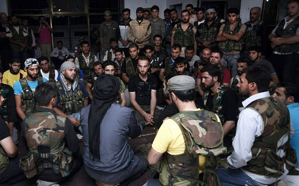 Free Syrian Army soldiers gather at the border town of Azaz, some 20 miles (32 kilometers) north of Aleppo, Syria, in July 2012. (photo credit: AP/Turkpix)
