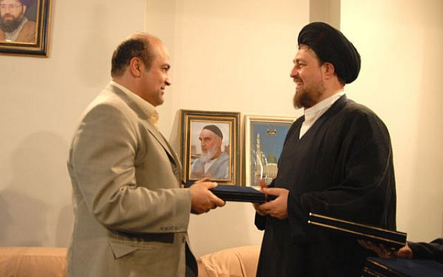 Siamak Moreh Sedgh (left), greets Sayyed Hassan Khomeini, grandson of Ayatollah Ruhollah Khomeini, the founder of the Islamic Republic of Iran. (photo credit: Website of Iran's Jewish community)