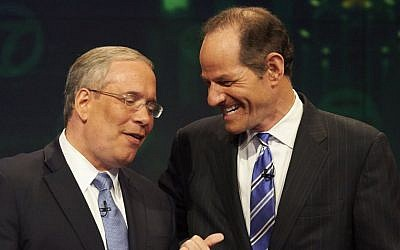 Manhattan borough president Scott Stringer, left, and former New York Gov. Eliot Spitzer. (photo credit: AP Photo/New York Daily News, James Keivom, Pool, File)