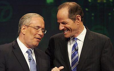 Manhattan borough president Scott Stringer, left, and former New York Gov. Eliot Spitzer. (photo credit: AP Photo/New York Daily News, James Keivom, Pool, File)