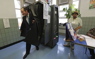 Democratic comptroller hopeful Eliot Spitzer exits the voting booth after casting his vote in the primary election at his polling station in New York, Tuesday, Sept. 10, 2013. (photo credit: AP/Mary Altaffer)