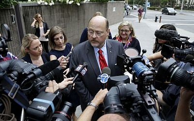 Republican mayoral hopeful Joe Lhota talks with reporters as he arrives to his polling station during the primary election in New York, Tuesday, Sept. 10, 2013. (photo credit: AP Photo/Seth Wenig)