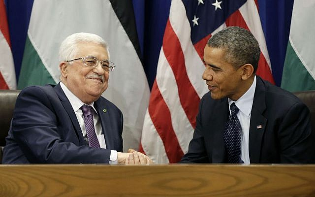 US President Barack Obama right) greets Palestinian Authority President Mahmoud Abbas during their bilateral meeting at UN headquarters, September 24, 2013. (AP/Pablo Martinez Monsivais)