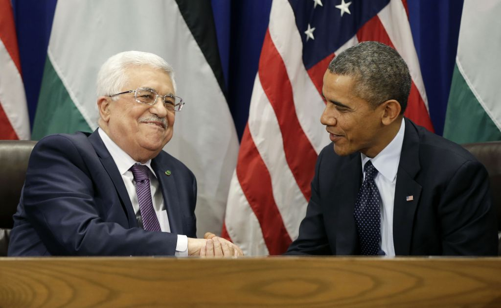 US President Barack Obama shakes hands with Palestinian Authority President Mahmoud Abbas during their bilateral meeting at the United Nations headquarters, on Tuesday, September 24, 2013. (photo credit: AP/Pablo Martinez Monsivais)