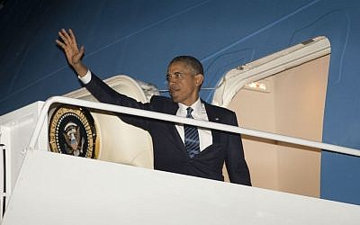 US President Barack Obama waves as he boards Air Force One before his departure on Tuesday to Sweden and Russia (photo credit: AP/Pablo Martinez Monsivais)
