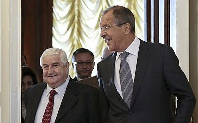 Russian Foreign Minister Sergey Lavrov welcomes his Syrian counterpart Walid Moallem (left), prior to talks in Moscow on Monday, September 9, 2013. (photo credit: AP/Ivan Sekretarev)