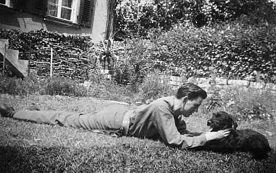 J.D. Salinger plays with his dog, Benny. (photo credit: AP Photo/The Story Factory, Paul Fitzgerald)