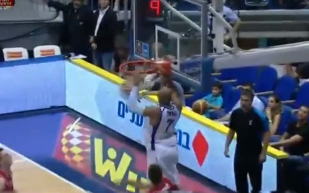 Illustrative photo of Alex Tyus rocking the rim in Israel's qualifying match for EuroBasket 2013 (photo credit: screen capture michagant/Youtube)