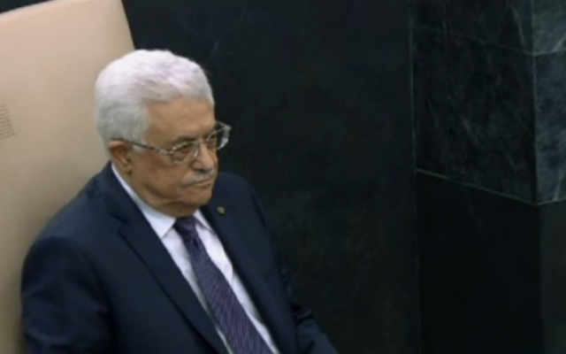 PA President Mahmoud Abbas sits in the heads-of-state seat before his September 26, 2013, address to the UN General Assembly. (photo credit: UN screenshot)