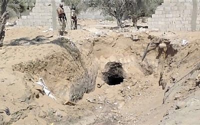 Egyptian army personnel supervise the destruction of tunnels between Egypt and the Gaza Strip at the border, near the town of Rafah, northern Sinai, Egypt, September 2013. (photo credit: AP/AP Television)