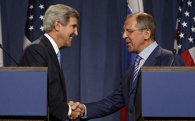 US Secretary of State John Kerry shakes hands with Russian Foreign Minister Sergey Lavrov (right), during a press conference before their meeting to discuss the ongoing crisis in Syria, in Geneva, Switzerland, on Thursday, September 12, 2013. (photo credit: AP/Larry Downing)