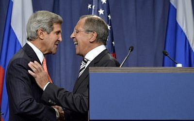 US Secretary of State John Kerry, left, shakes hands with Russian Foreign Minister Sergey Lavrov at a news conference in Geneva, Switzerland, last September (photo credit: AP/Keystone/Martial Trezzini)