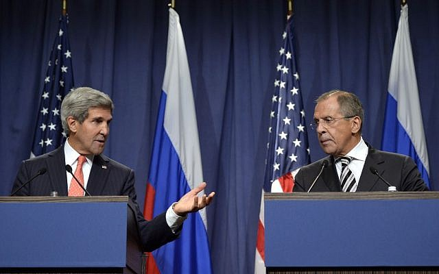 U.S. Secretary of State John Kerry, left, and Russian Foreign Minister Sergei Lavrov, right, deliver statements in Geneva, Switzerland, Saturday Sept. 14, 2013. (photo credit: AP Photo/Keystone,Martial Trezzini)
