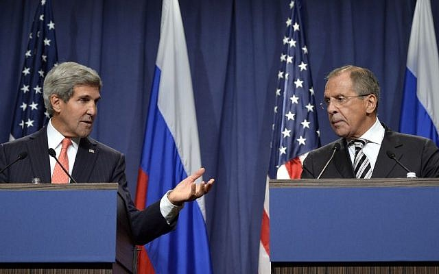 US Secretary of State John Kerry, left, and Russian Foreign Minister Sergey Lavrov, deliver statements on the situation in Syria, from Geneva, Switzerland, Sept. 14, 2013 (photo credit: AP/Keystone/Martial Trezzini)