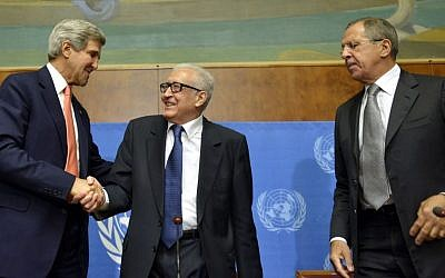 US Secretary of State John Kerry, left, shakes hands with the UN Joint Special Representative for Syria Lakhdar Brahimi, center, next to Russian Foreign Minister Sergei Lavrov during a press conference after their meeting at the European headquarters of the United Nations in Geneva, Switzerland, on Friday (photo credit: AP/Keystone/Martial Trezzini)