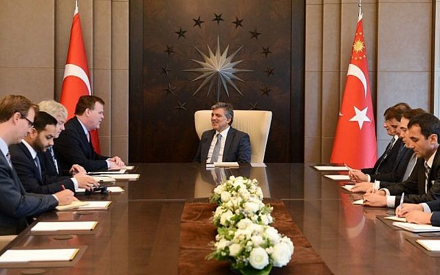 In this photo released by the Turkish Presidency Press Office, Turkish President Abdullah Gul, center, and Canadian Foreign Minister John Baird, center left, speak during a meeting in Istanbul, Turkey, Saturday, Sept. 14, 2013. (Photo credit: AP/Ayhan Arfat, Turkish Presidency Press Office)